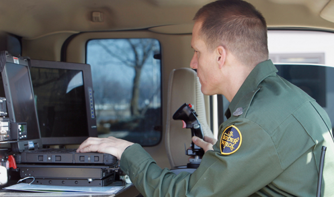 A U.S. Customs and Border Protection, Border Patrol Agent operates border security mobile equipment. Photo: CBP Photography/ Flickr